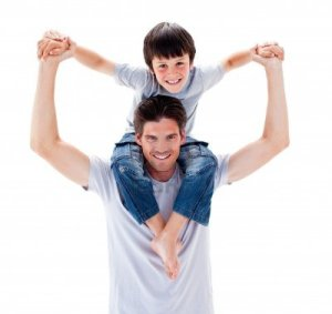 10091526-charismatic-father-giving-his-son-piggyback-ride